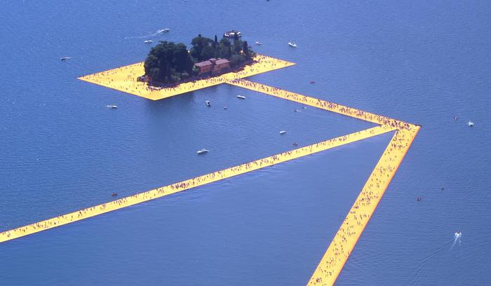 The Floating Piers' by Bulgarian artists Christo and Jeanne-Claude on Lake Iseo during the opening of the art work near Sulzano, northern Italy, 18 June 2016. The 'Floating Piers' with their bright orange covers will be open until 03 July and will connect the two towns Sulzano and Monte Isola. ANSA/ FILIPPO VENEZIA
